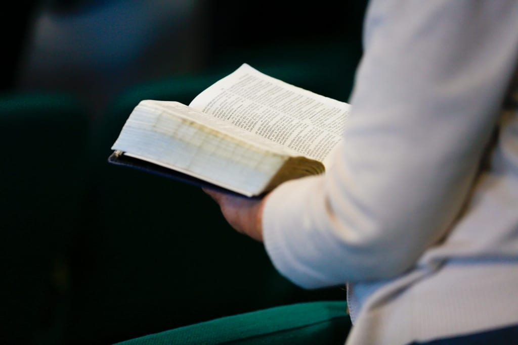 someone reading the Bible at calvary tabernacle in lynnwood washington