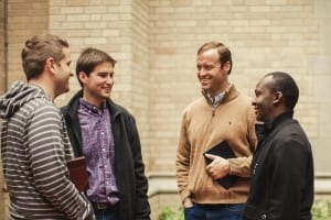 men chatting outside of calvary tabernacle